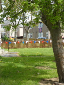 Photograph of streetcene with visible bunting and flags