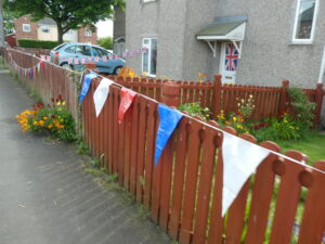 Photograph of bunting on fence