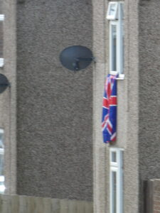 Photograph of flag flying from window