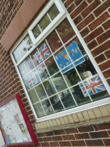 Photograph of Village Hall window with flags