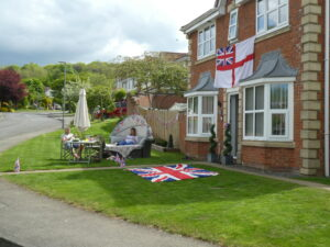Photograph of residents enjoying VE day in their own garden