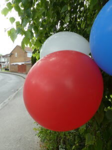 Photograph of blue, red and white baloons