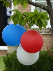 Photograph of a red white and a blue balllon