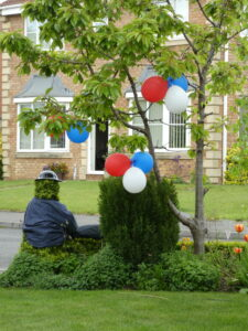 red white and blue balloons in a tree