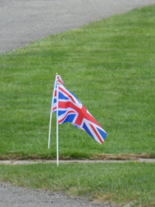 Photograph of two flags on lawn