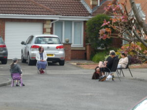 Photograph of socially distanced neighbours