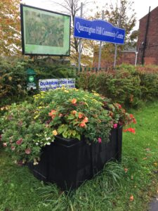 view of flowers and sign at Quarrington Hill Community Centre