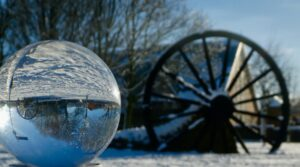 pit wheel in snow reflected in lensball