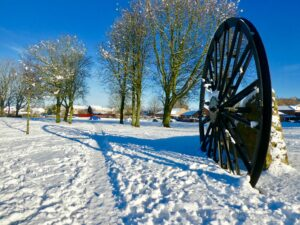 snow on the ground and blue skies with the wheel in Coxhoe